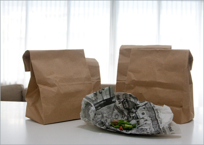 Reusable paper bags and old newspaper